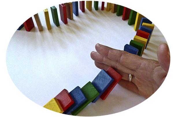 hand interrupts dominoes